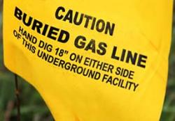 Yellow flag indicating a buried natural gas line